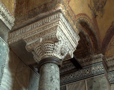 Intricate work on the top of a column. Nice tile and mosaics too.