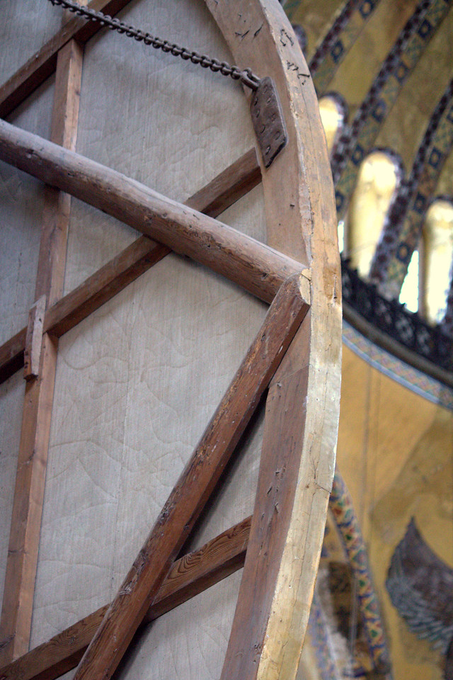 Looking a the back of the Islamic calligraphy panel. Wood and leather.