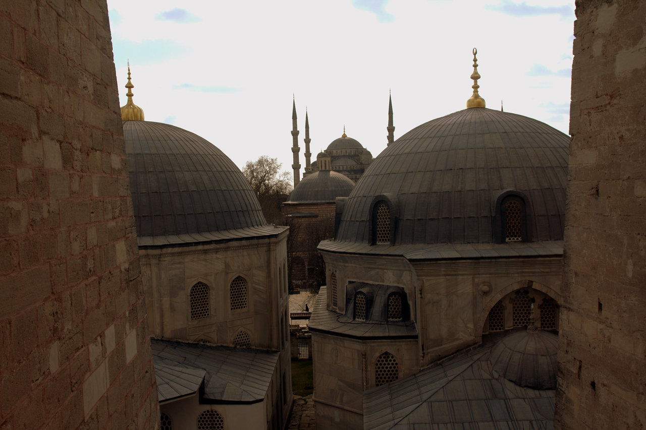 Looking out the Hagia Sophia at auxillary domes and the Blue Mosque.