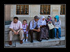 """Family sitting in Sultanahmet """"Blue"""" Mosque courtyard"""