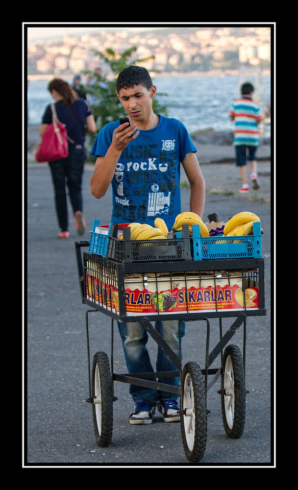 IMAGE: https://photos.smugmug.com/Travel/Istanbul/i-Wd3D2js/0/e705153b/X2/Bananna%20Vendor-X2.jpg