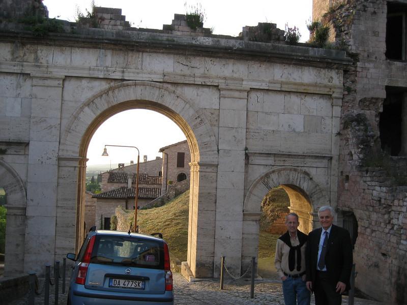 Neal and Enrico (Vito) in front of the Roman Porta Venere, Spello.