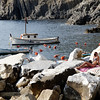 Cinque Terrre / Riomaggiore - this is the harbour area, with a young lady enjoying the sunshine.