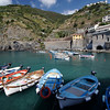 Cinque Terrre / Vernazza - these are some of the many boats moored in the small enclosed harbour.  The trail to Monterosso is on the side of the hill at the far side of the photo.  The railway tracks are located to the left of the yellow building that can be seen on the far side.