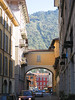 Como - arch over roadway, mountain in bg