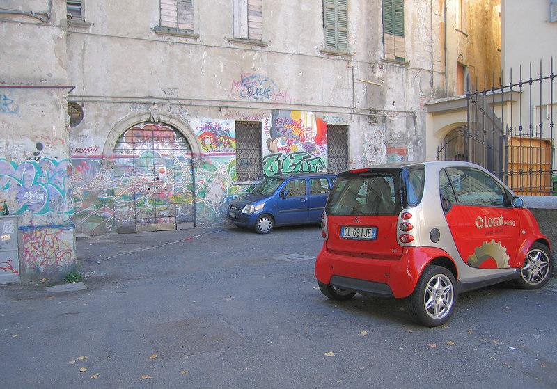 Small cars, grafitti in Como