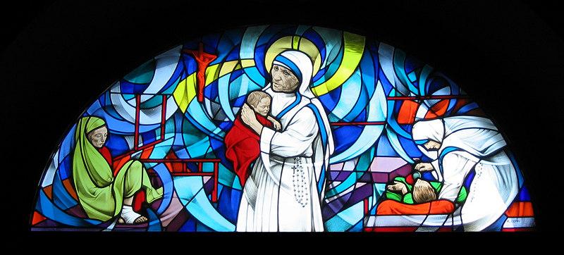 00aFavorite Stained glass inside Inverigo church - a nun