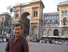 Dilip in Piazza Duomo with Galleria Vittorio Emanuele entrance in back