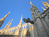 00aFavorite On top of Duomo di Milano - Sculpture of a duck or lizard in fg, wide shot