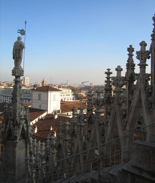 On top of Duomo di Milano - peering past a statue