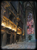 Inside Duomo di Milano - looking toward huge multi-paned stained glass [borderfade4]