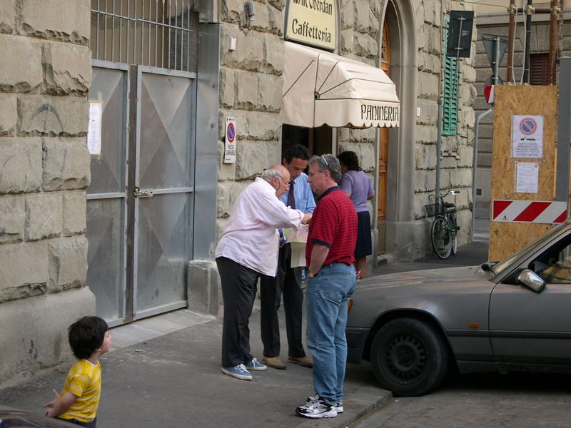 Bus driver getting directions to the hotel in Florence.