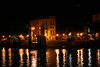 Varenna, Lago di Como -  Night view of Albergo Olivedo and the dock area.