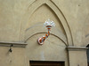 Decorative ceramic light fixture in the Unicorn contrada.