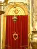 I know the curtain veils something important.<br /> <br /> Edit: Thanks to Amy, this is the parokhet, which veils the ark containing the Torah.