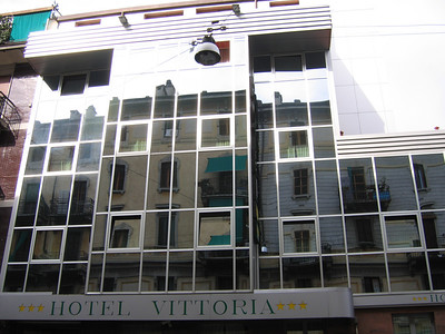 Our first hotel, Hotel Vittorio, with its mirrored facade reflecting the flats across the street in Milan.