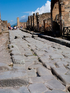 Wagon wheels from almost 2,000 years ago left their mark in the stone roads. Pompeii