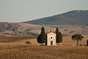 This is an abandoned chapel visible in the distance on the road between Pienza and San Quirico d'Orcia.