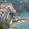 Sorrento, on the Bay of Naples.  The coast is very rocky and steep, and beach area is scarce.  Here a small stretch of sand beach is jammed with umbrellas that must be rented.