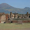 The remains of the Temple of Jupiter at the north end of the Forum in Pompeii, with Vesuvius.