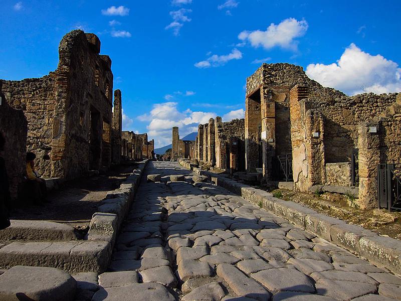 Street scene at Pompeii with Mt. Vesuvius in the background.