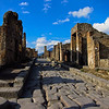 Street scene at Pompeii with Mt. Vesuvius in the background.