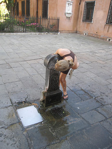 Julie takes a drink from the fountains in every piazza in Venice.