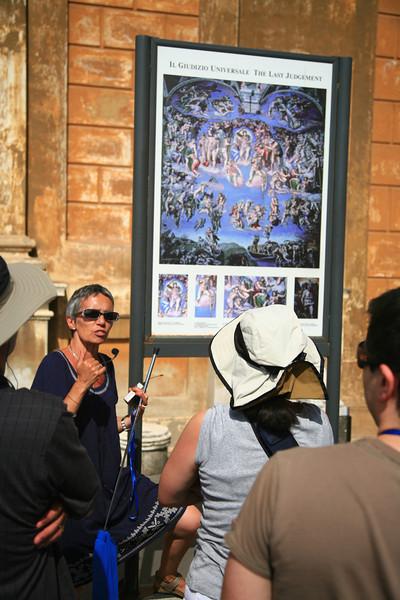 Our tour guide explains how Michaelangelo deviously hid a self-portrait in his Last Judgment.