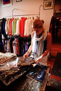 Julie scours a shop for scarves.