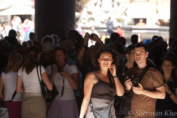Tourists at the Pantheon. The light came through the open ceiling and reflected off the marble floor.