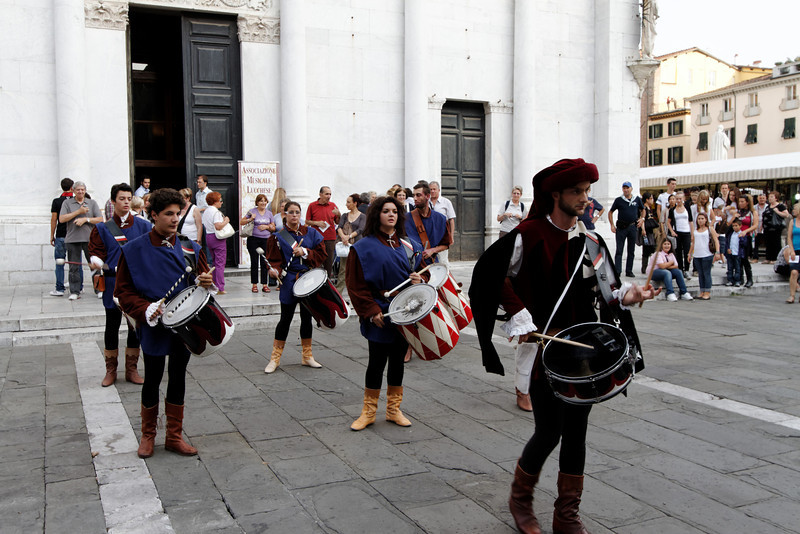Tuscany - Lucca.  This small drum band in period costumes was performing the afternoon I arrived in Lucca.  They first led a procession of dignitaries into the Church behind them, and then provided a short concert in front of the Church.