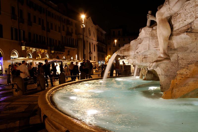 Rome - Piazza Navona.  This is a partial view of the Fontana dei Quattro Fiumi (Fountan of the Four Rivers) in the centre of the Piazza, and some of the crowd that is typical on most evenings.