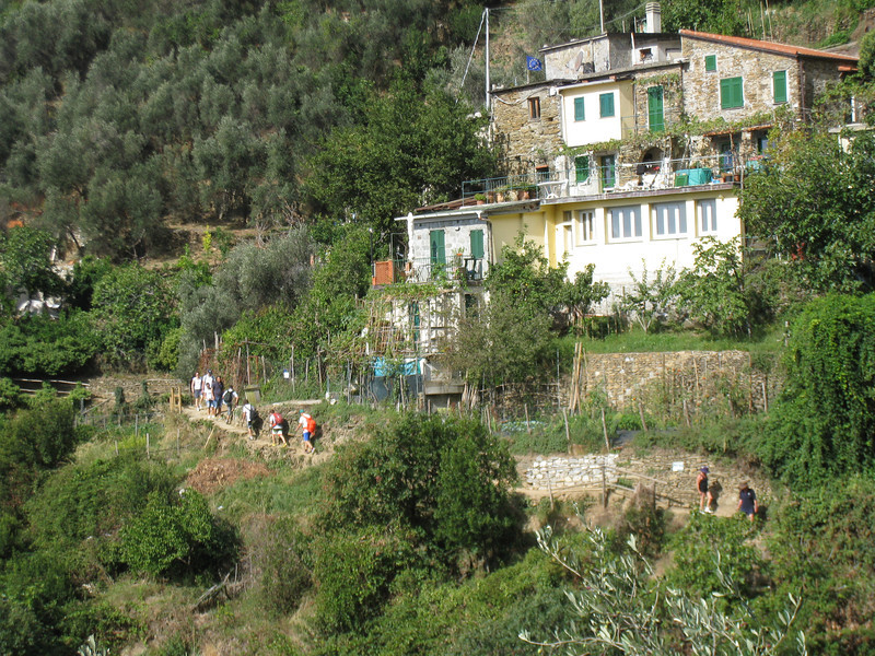 """Cinque Terre - """"The Trail"""".  This shows another view of one of the homes along the trail from Monterosso to Vernazza.  There were a LOT of hikers on the morning I made the trek, some of whom can be seen in this photo."""