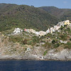 Cinque Terre - Corniglia.  Although this village is located high on a rocky bluff, there is a small beach area (which can be faintly seen in the lower centre of the photo).