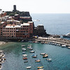 Cinque Terre - Vernazza.  A closer view of the town, the small harbour and the passenger boat that runs between the five villages (weather permitting).