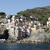 Cinque Terre - Riomaggiore.  The area at the lower right with all the people gathered on the rocks is where the boats dock.