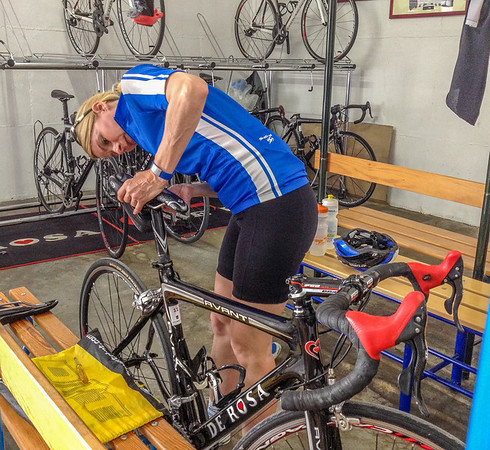 Calla installing her saddle on the rental De Rosa (very Italian with Campy kit)