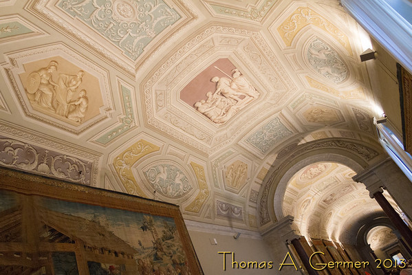 Inside the Vatican Museum, the Hall of Tapestries. Note that the ceiling is smooth and painted to appear to have relief.