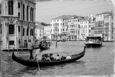 Gondolier at Venice canal.