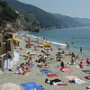 Monterosso - the main beach area in Fegina (new town), with many people enjoying the sun and the fantastic waters of the Ligurian Sea.