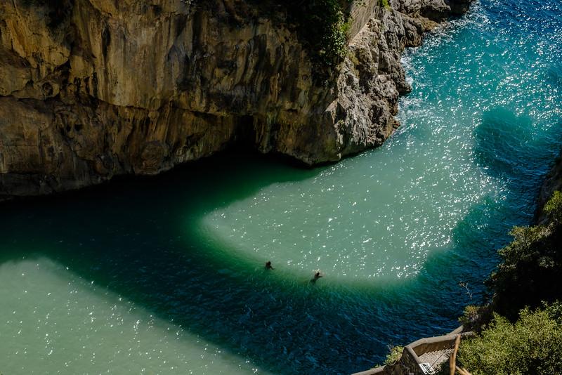 Swimmers in Fiordo di Furore below.