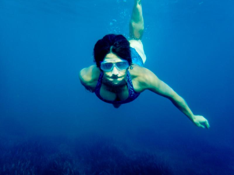 Lisa swimming in Positano.