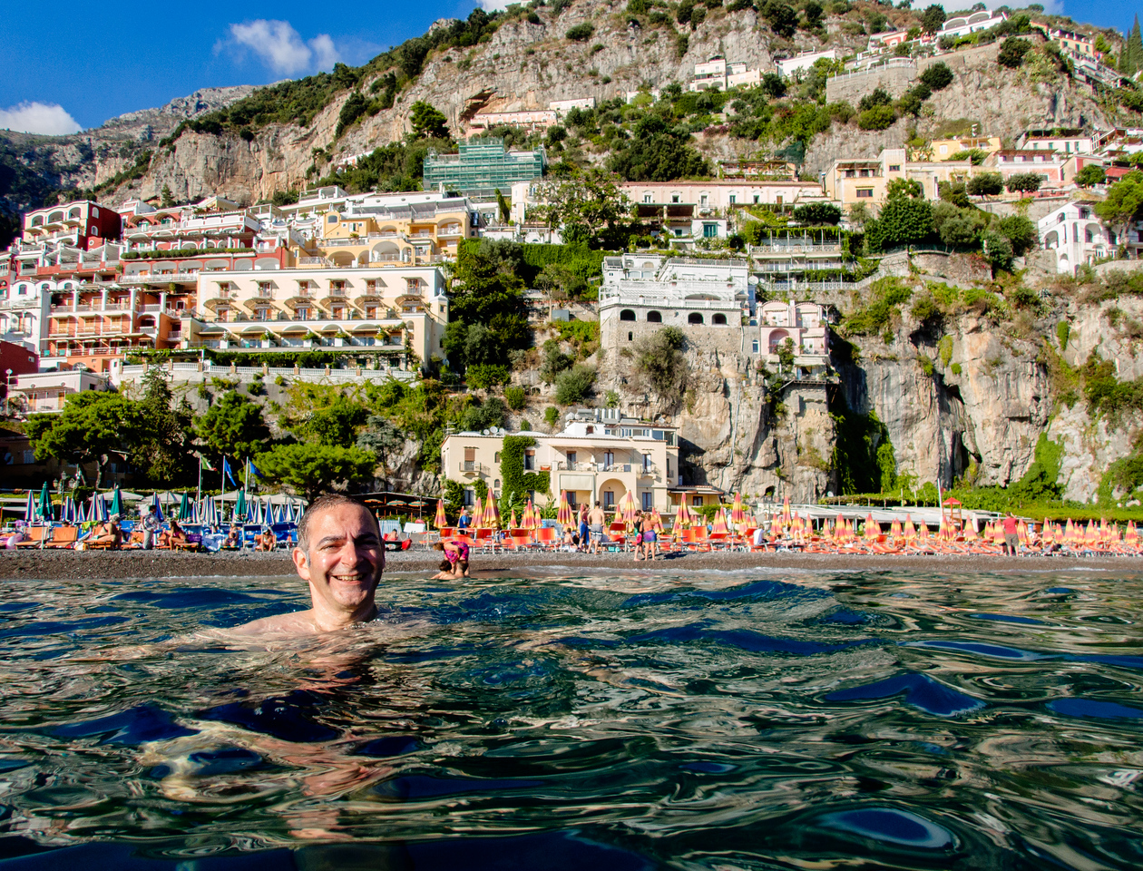 Rich swimming in Positano.
