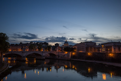 Looking west across the Tiber river toward the dome of St. Peter's Basilica.