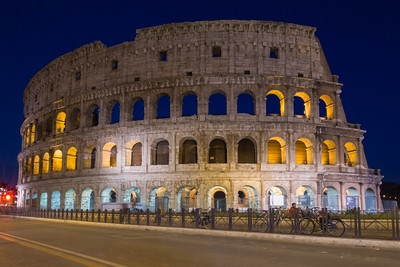 Standing in the road, another of the Colosseum at night. The annoying green lights (look closely) on the facade are from green lasers being hawked all over Italy.