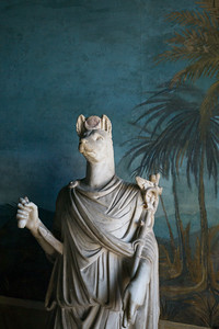 A first century AD toga-clad Roman statue of Anubis, lord of mummification, who guided the dead to the underworld. Inside the Vatican Museum.