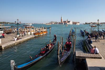 Gondolas on the lagoon and the Church of San Giorgio Maggiore in the background.