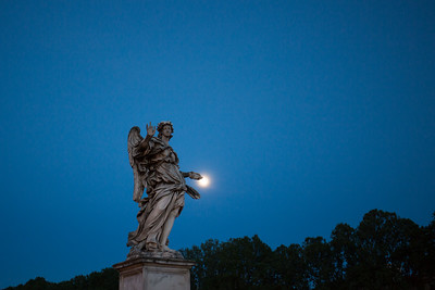 Angel with the Nails and the full moon on Ponte Sant'Angelo.