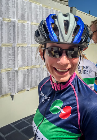 Calla at Colnago Cycling Festival check-in.  Roster of racers is behind her.