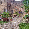 A colorful courtyad on a back road in Polzano